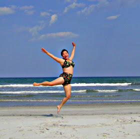 "Johnna Jo wearing her Two-Piece Classic: Johnna says: ""I was leaping for love while visiting my best friend in Fernandina Beach, FL! I bought this suit 5-6 years ago and I still love it!"""