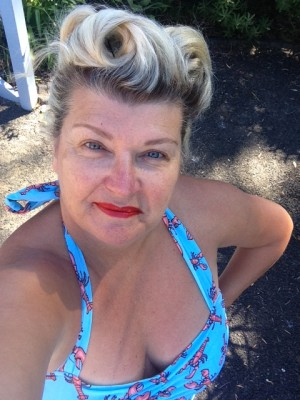 "Lizzie in her Classic Sheath Lobster! Lizzie says: ""Loving this cossie! Currently on a beach holiday south of Sydney. My friend Bec wore my gorgeous red one-piece this morning. She looked fabulous and is now an Esther Williams convert!"""