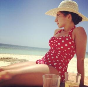 Mina in her Classic Sheath in Red with White Dots on a beach in Cancun. Classic and stylish!