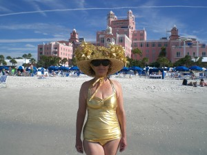 Monika is wearing her Classic Sheath in Solid Gold. She sends her greetings from the Gulf Coast in Florida, enjoying a walk on the beach by Pass-A-Grille.